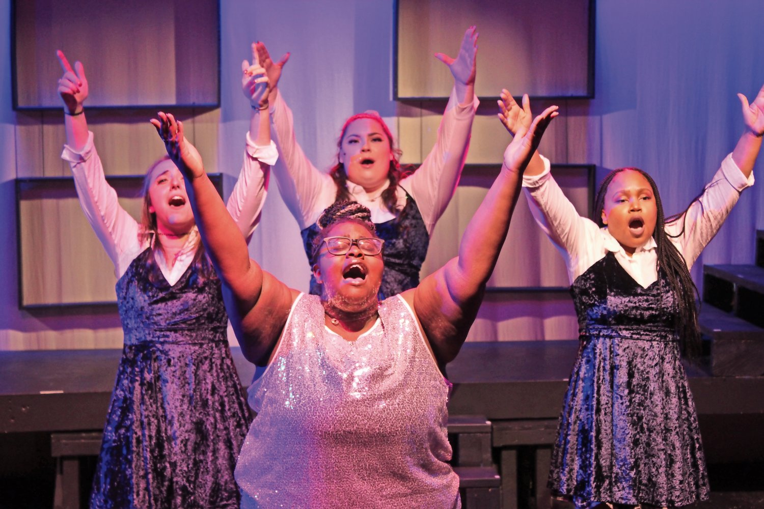 "Sister Chantelle, played by Janelle Primm, and her angelic back-up singers wowed the crowd with the song ""911 Emergency!"""