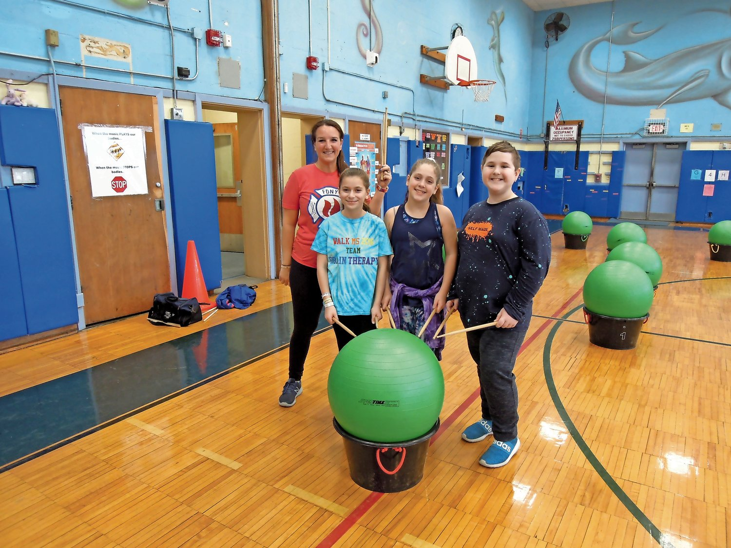 Mandalay physical education teacher Robyn Pastuch, from left, Addison Gottlieb, Nikki Lonergan and Marc Walters explained why they like cardio drumming.