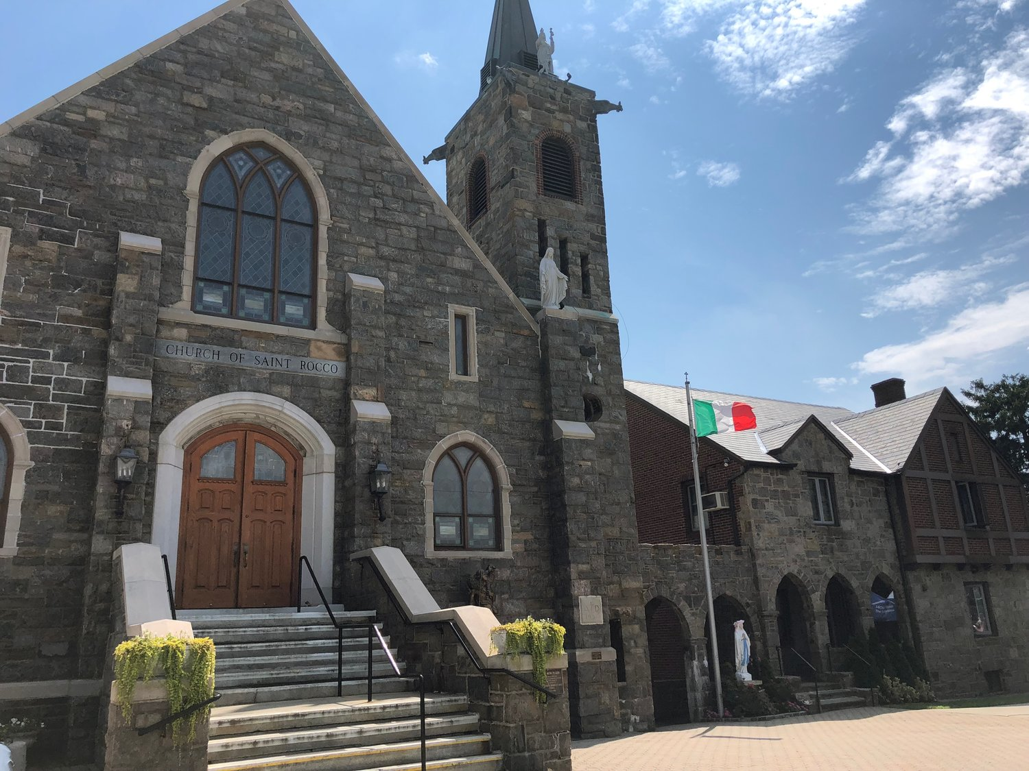 An alleged victim of the Rev. Eligio Della Rosa is asking that the priest's name be removed from a parish center at the Church of St. Rocco.