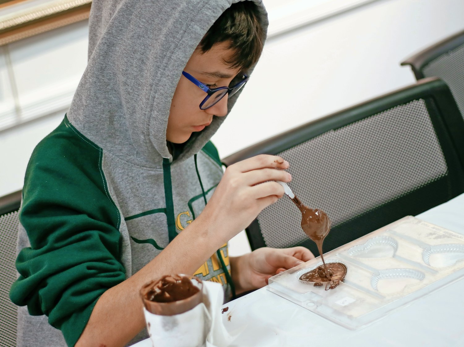 Giovanni Scimeca, 12, made sure to fill the chocolate mold to maximum capacity.