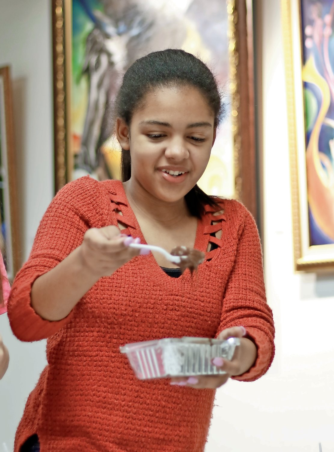 After dipping her Oreo in melted chocolate, Janna Okolie, 12, added Sweet Tarts to the top for decoration.