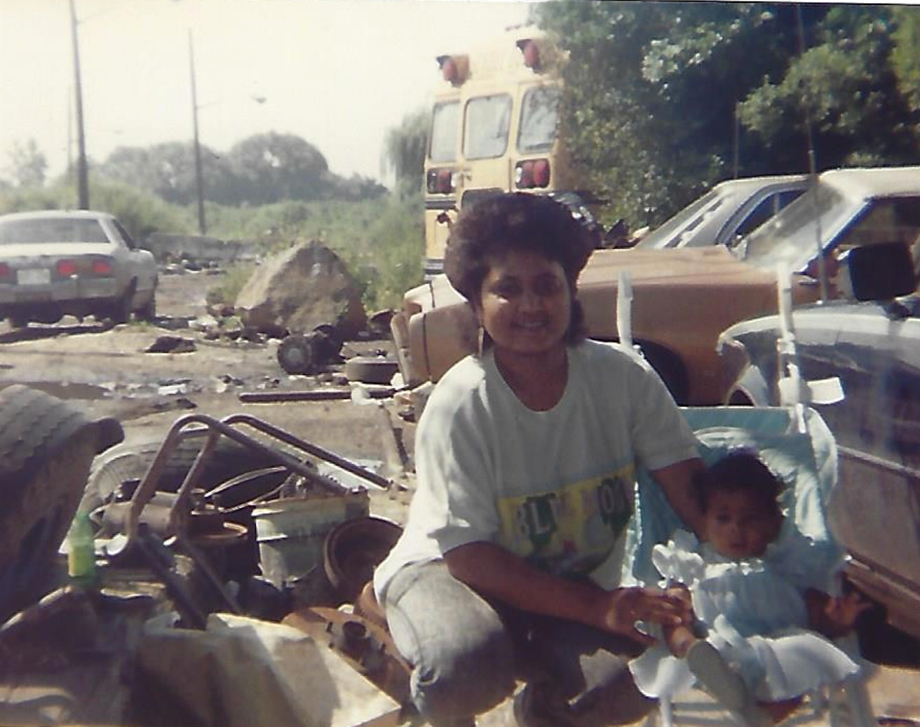 Longtime Valley Streamer Orville Davis — the toddler at right — with his mother, Sonia, at his father's Queens scrapyard, circa 1990. Davis now has his own eco-friendly scrap-hauling business.