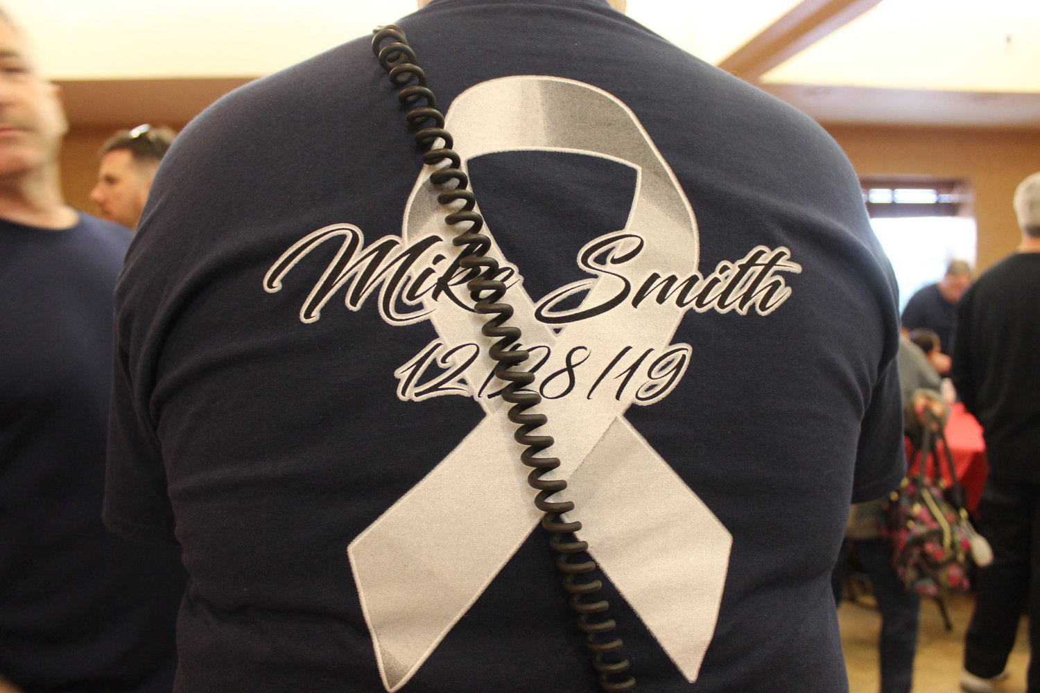 Engine Company #2 members made shirts to commemorate the loss of ex-captain Michael Smith.