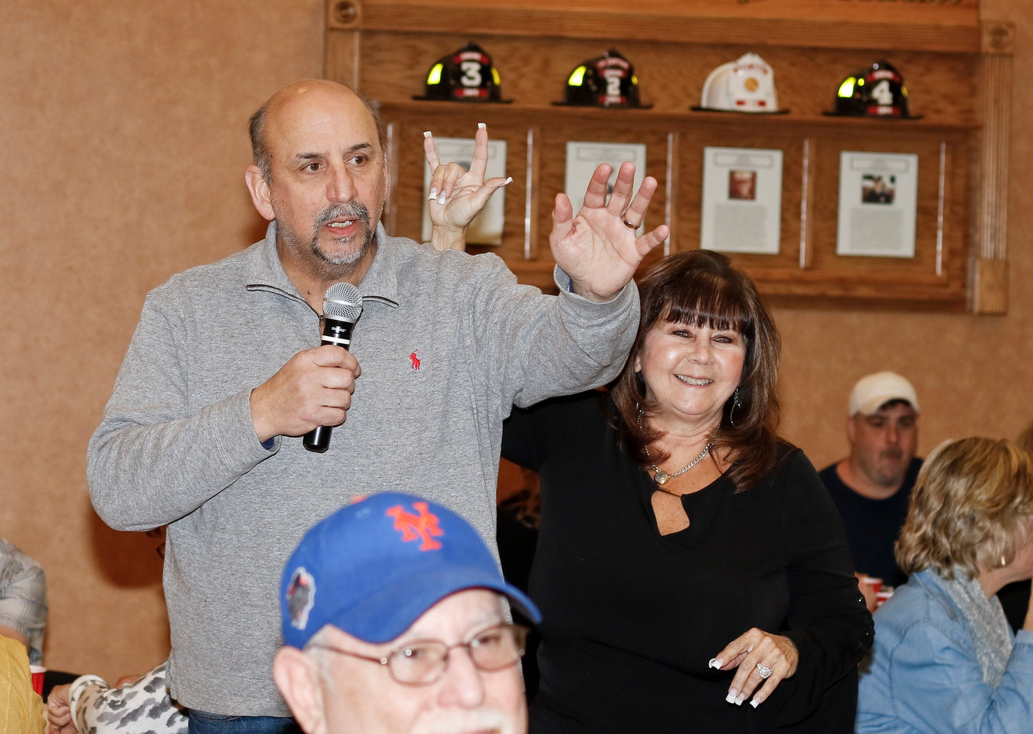 East Meadow Kiwanis President Alan Beinhacker welcomed everyone to the organization's 11th annual Name that Tune fundraiser, based off the 1950s game show of the same name, on Feb. 7 at the East Meadow Fire Department Headquarters. Past President Debbie Kirsh showed her love in sign language.