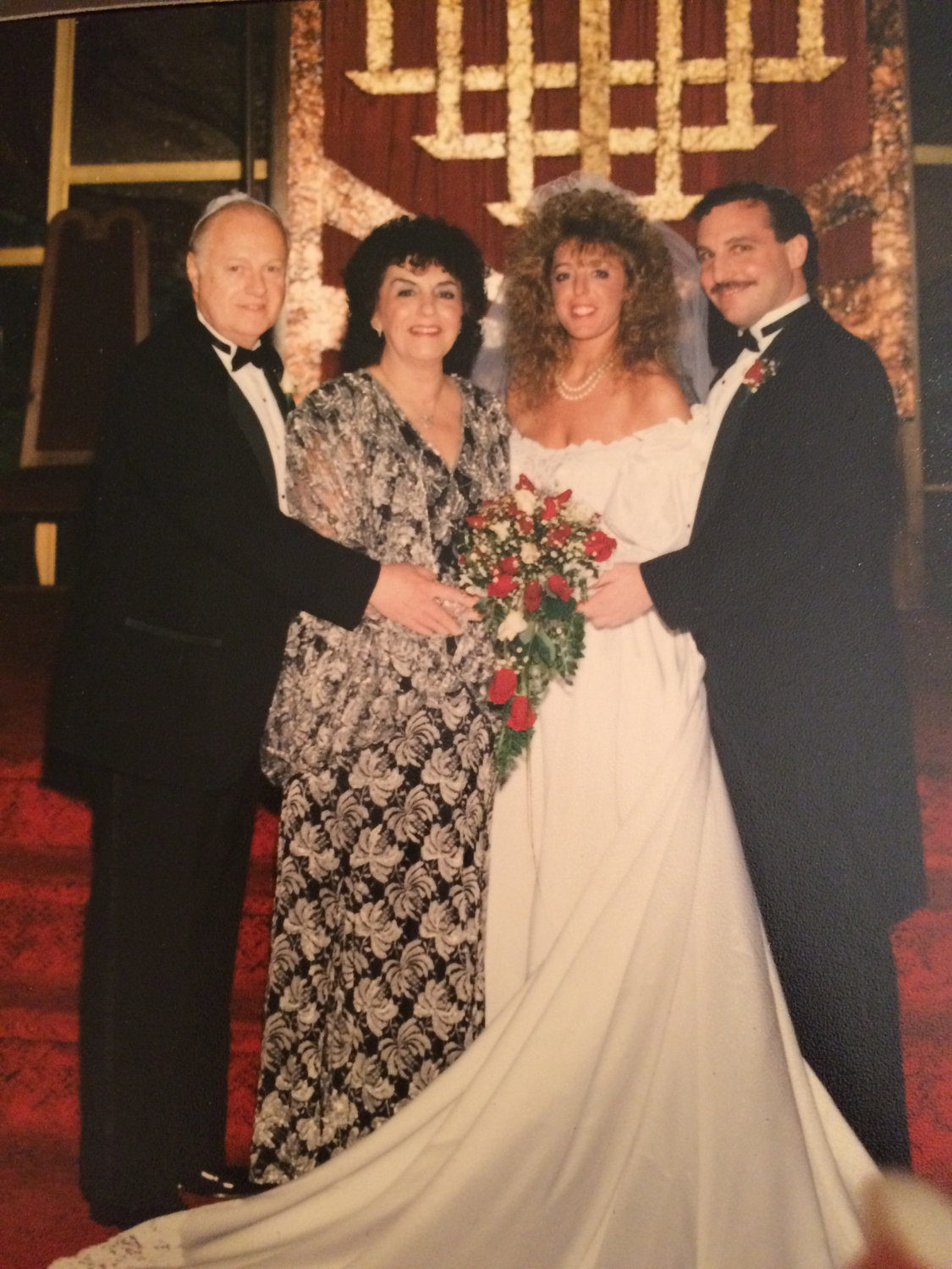 Bonni and Walter on their wedding day with Bonni's parents Dr. Howard Gershenfeld and Shirley Gershenfield.