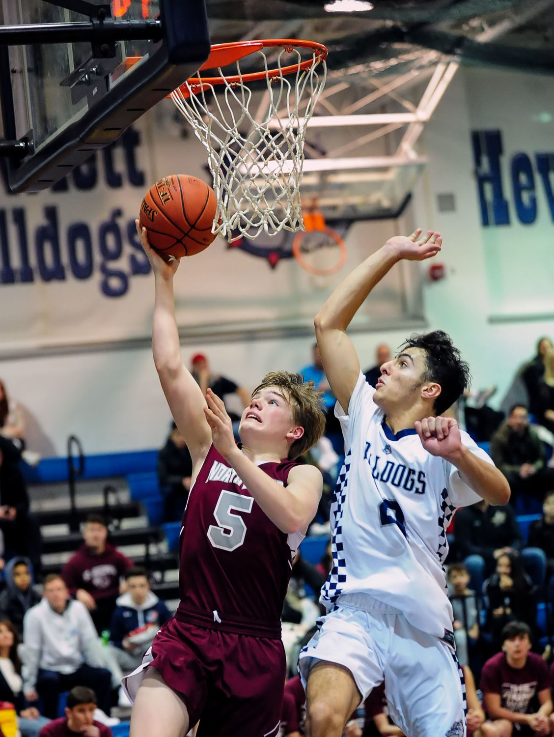 North Shore's Phil LaRosa, left, who scored a team-high 18 points, hit a layup with Hewlett's Sam Vanunu on his heels during the Vikings' playoff loss Feb. 13.