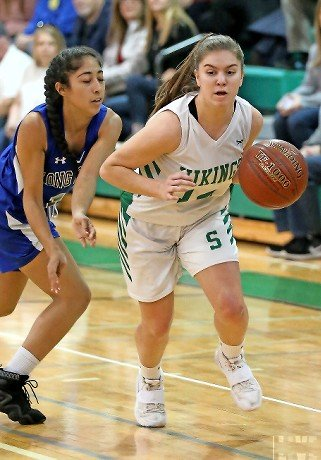 Seaford's Brook Surace, right, led all scorers with 19 points last Friday as the Lady Vikings advanced in the Nassau Class A playoffs with a 62-40 win over Long Beach.