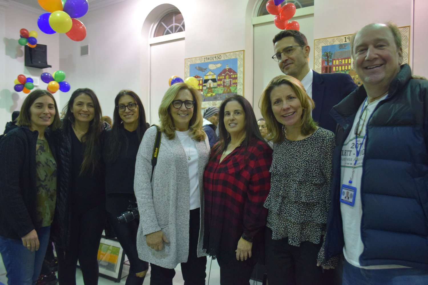 Art show organizers and supporters included from left, Adrienne Gupta, Cristina Marro, Suzanne Levy, Louise Edman, Elizabeth Tucker, Colleen O'Hara, Ross Cohen and David Friedman.