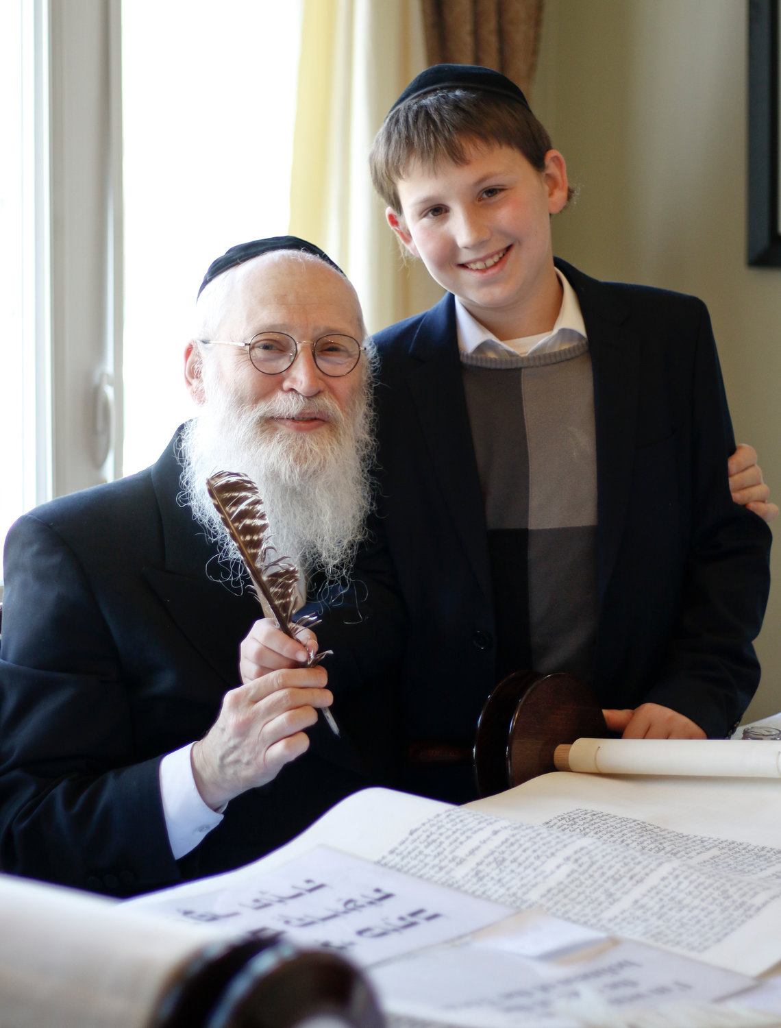 Nosson Tzvi Maik, right, came from Jerusalem to join the Fried family and Rabbi Moshe Klein as the Torah 