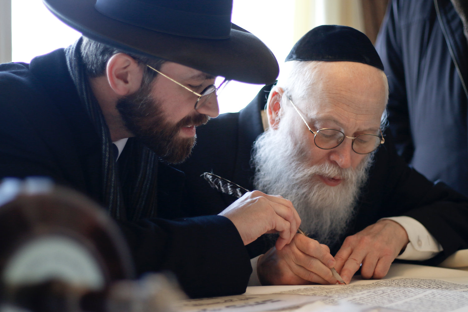Bais Tefilah Rabbi Ephraim Polakoff, left, joined sofer Rabbi Moshe Klein as he finished lettering the Torah scroll.