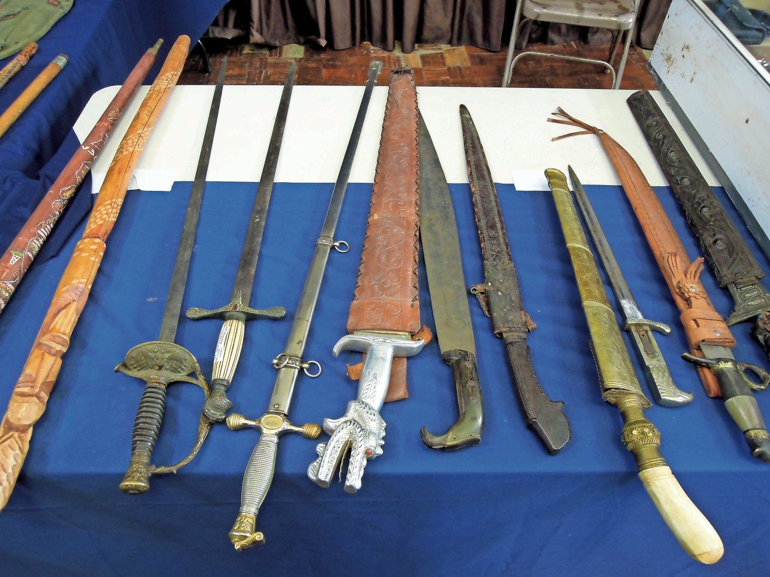 "Military memorabilia from ""Bill,"" including swords and bayonets from earlier conflicts."