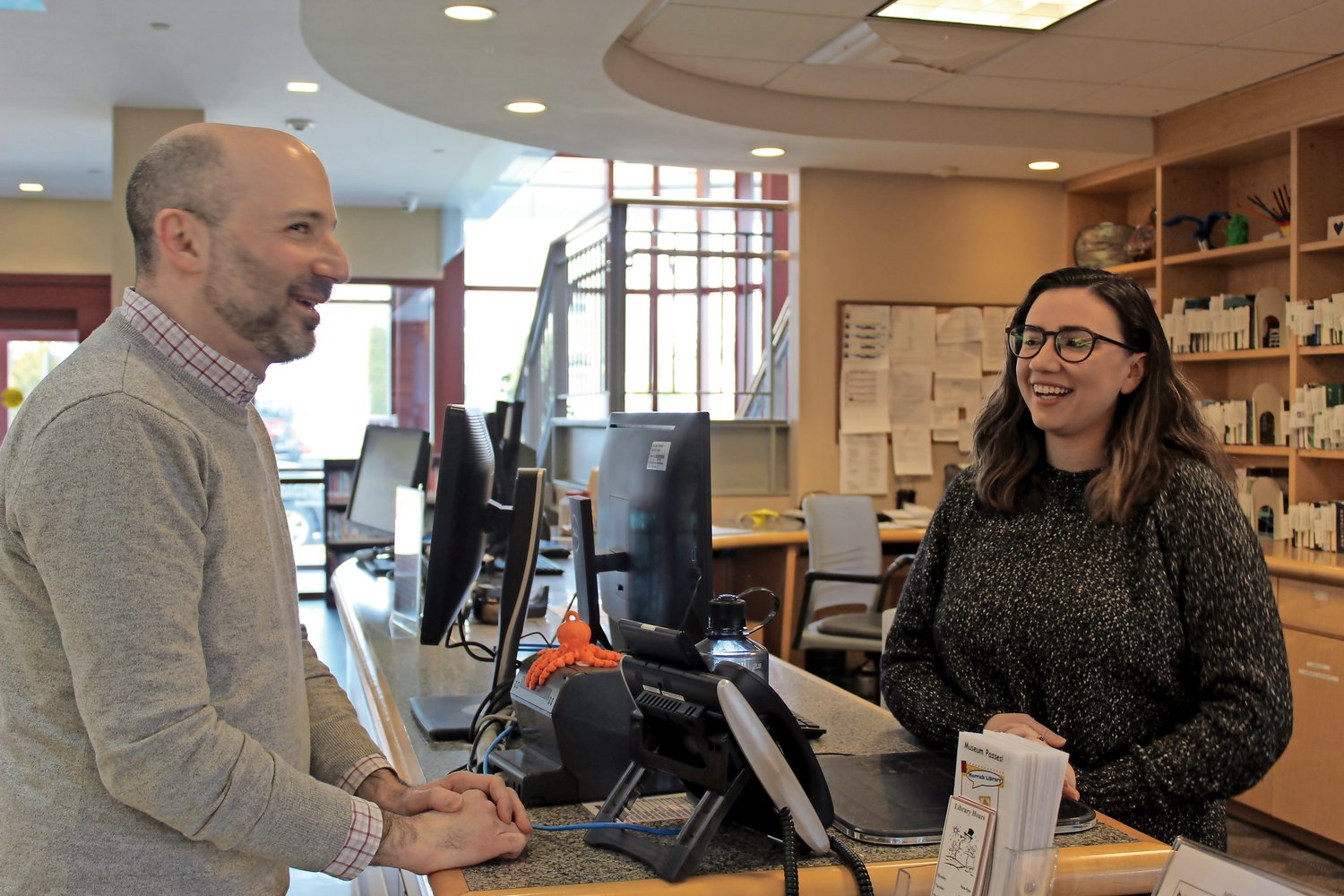 Dan Chuzmir chatted with circulation clerk Katherine Rubino at the front desk.