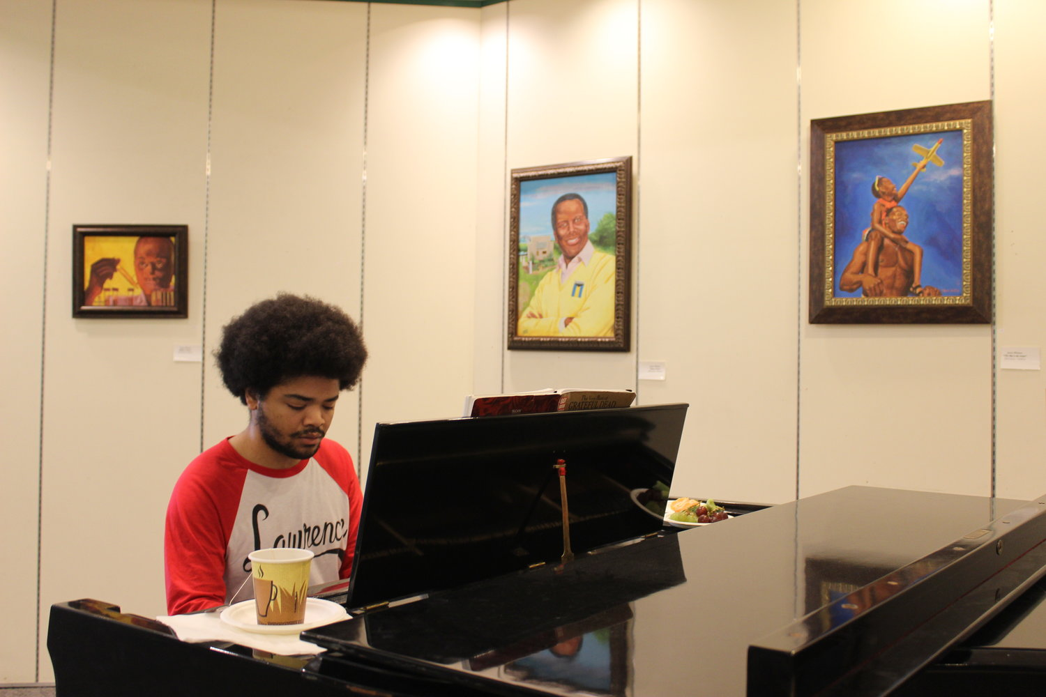 Richard Arriaga played piano at an opening reception for Whitten's exhibit last Saturday.