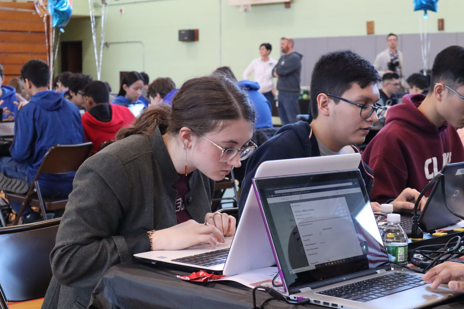Emma Passariello, a hacker on Clarke's team, above left, helped her group take first place.