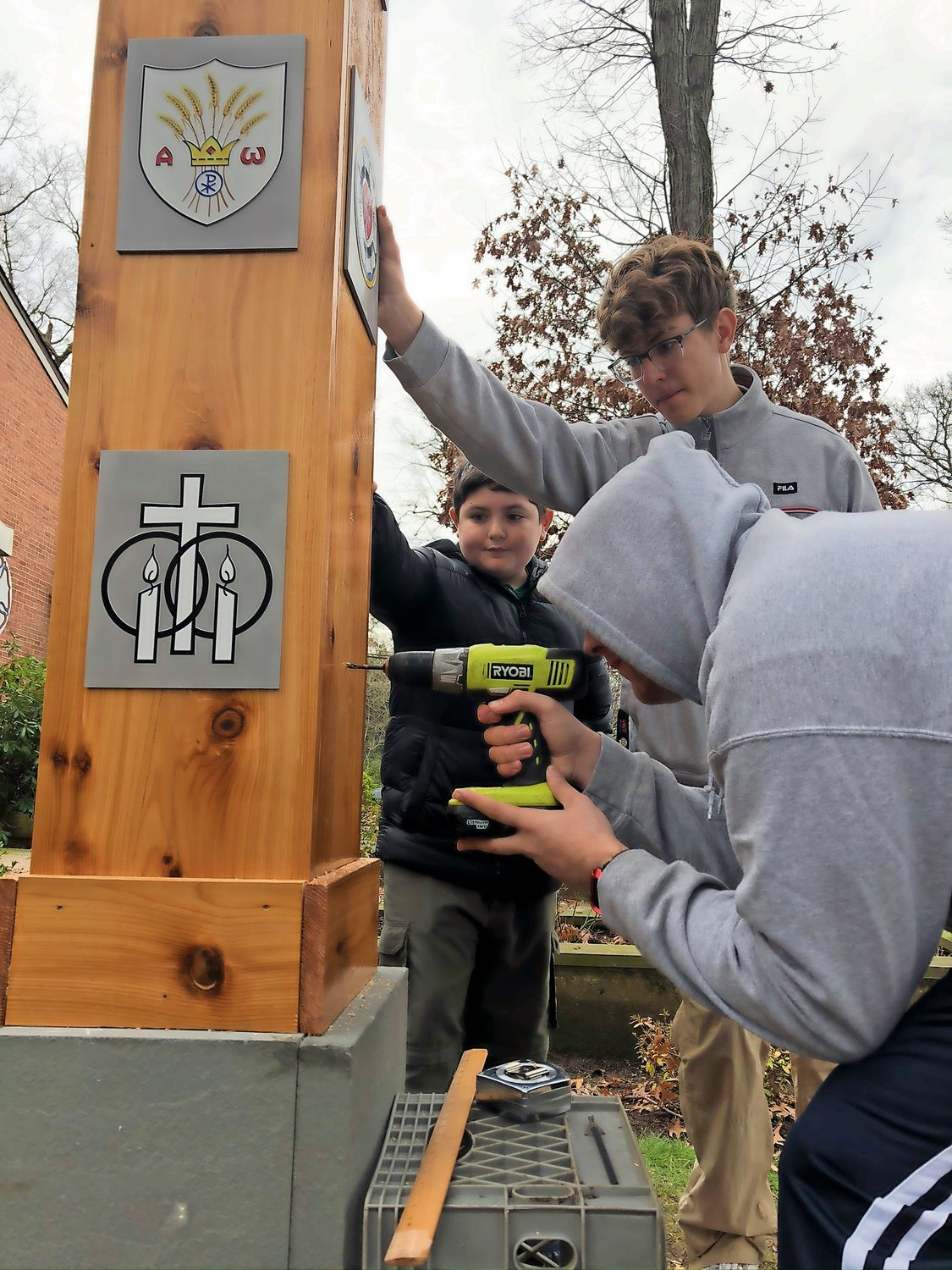 Conlon's fellow scouts helped him construct the peace pole..