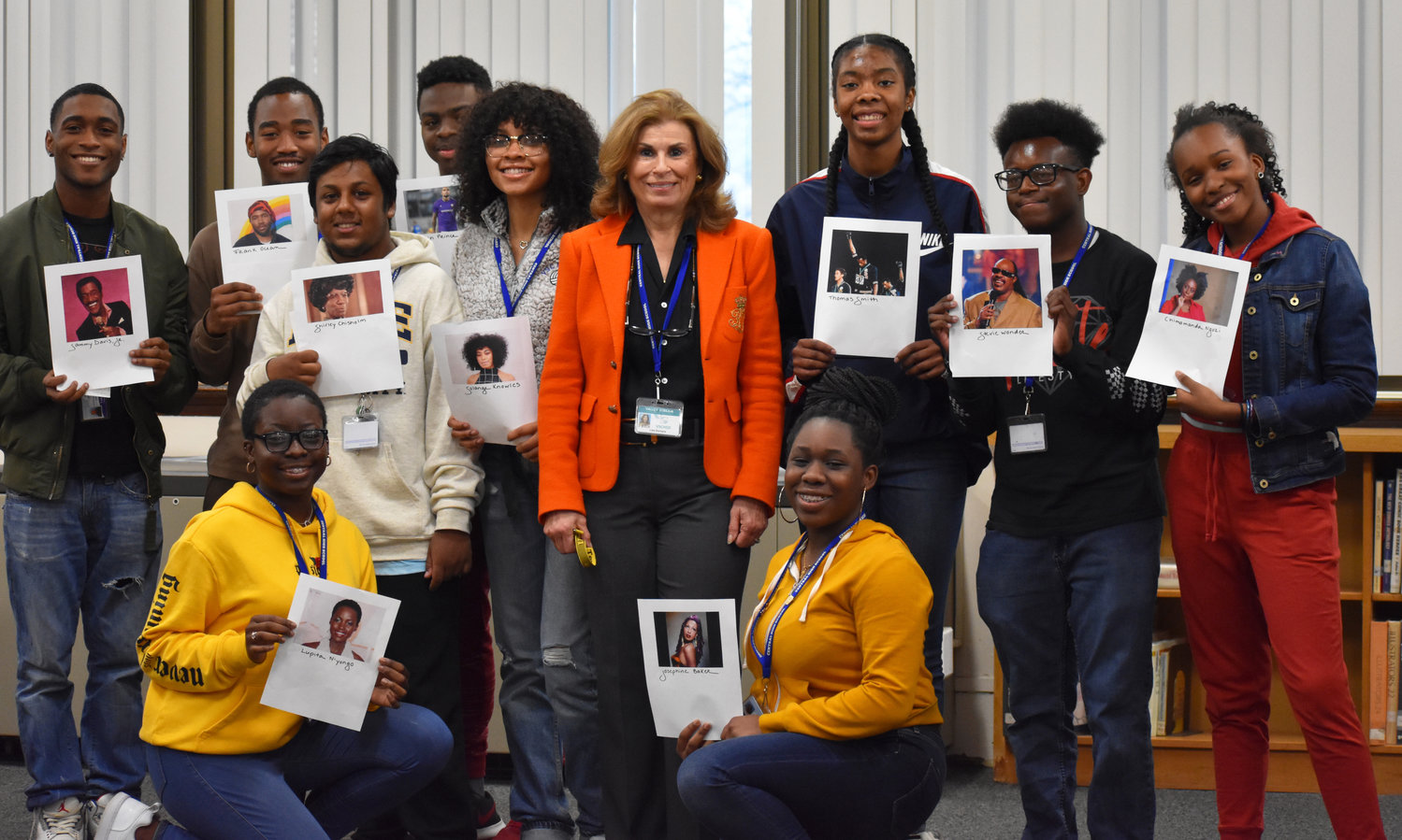 Ten Central High School students gathered in the school library on Feb. 13 to give presentations on black figures that inspire them. With them, at center, was library Media Specialist Lisa Dichiara.