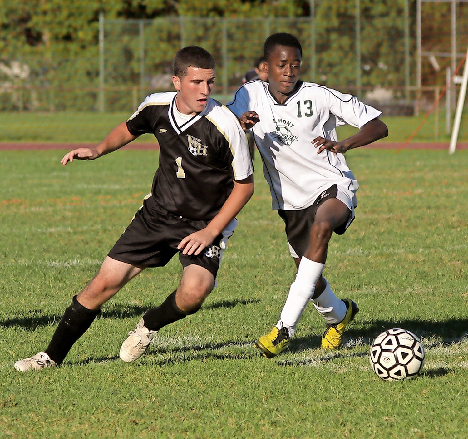 John Rogers, right, battled West Hempstead's Tom Valerio for a loose ball at a non-league game in 2010.