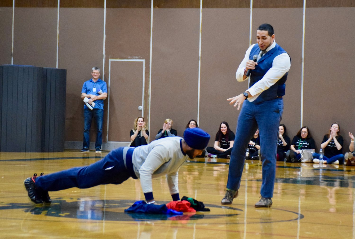 Lynbrook High School student Jassjeet Singh, left, volunteered to demonstrate exercises as Gonzalez spoke to the audience.