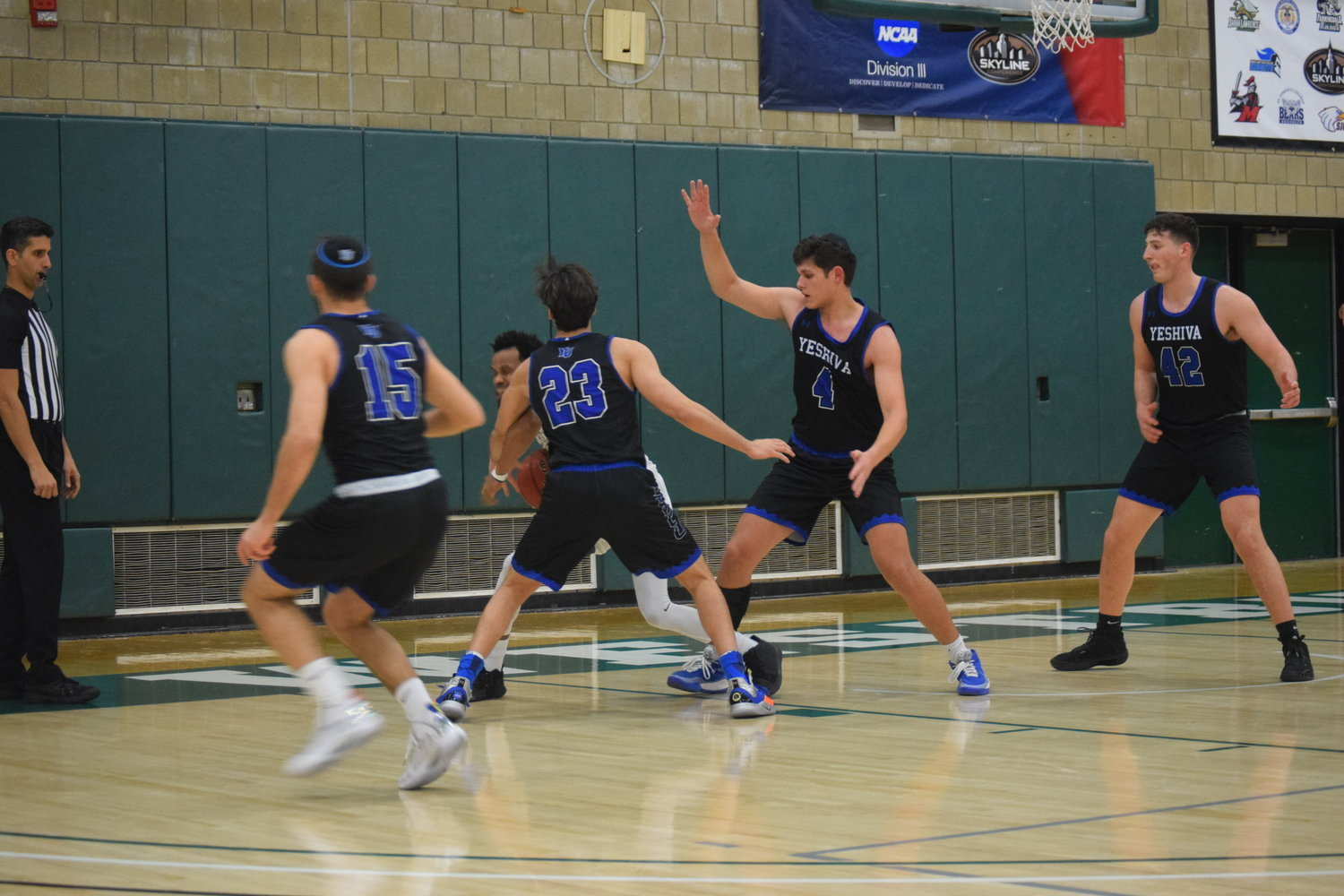 Yeshiva University's suffocating defense keys an offense that averages nearly 87 points a game. From left, Maccabees Eitan Halpert, Bar Alluf, Gabriel Leifer and Caleb Milobsky surrounded a SUNY Old Westbury player in the Feb. 18 win.