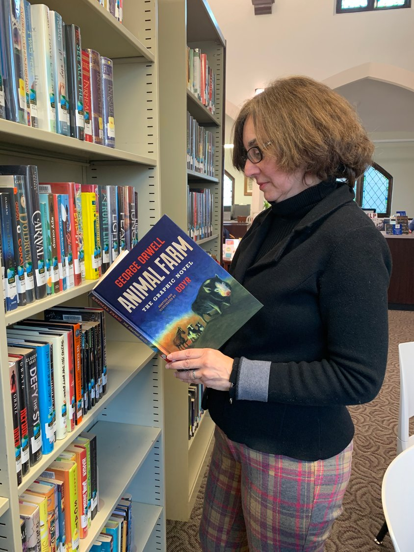 "Camille Purcell, the Sea Cliff Village Library's assistant director, who was recently promoted to director, has worked hard to expand the library's young adult section, which includes a graphic novelization of George Orwell's classic novella, ""Animal Farm."""