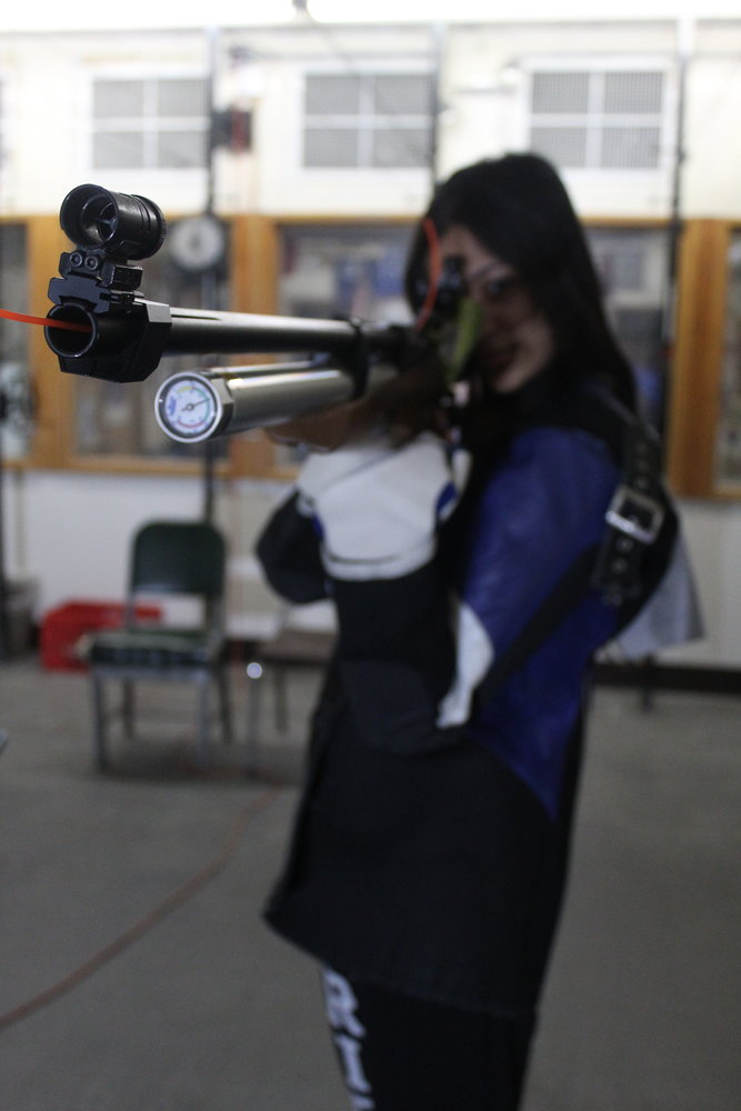 Zaidi with her rifle. While her team will be competing at the state level, it will be the last time New York holds rifle championships due to a lack of interest in the sport.