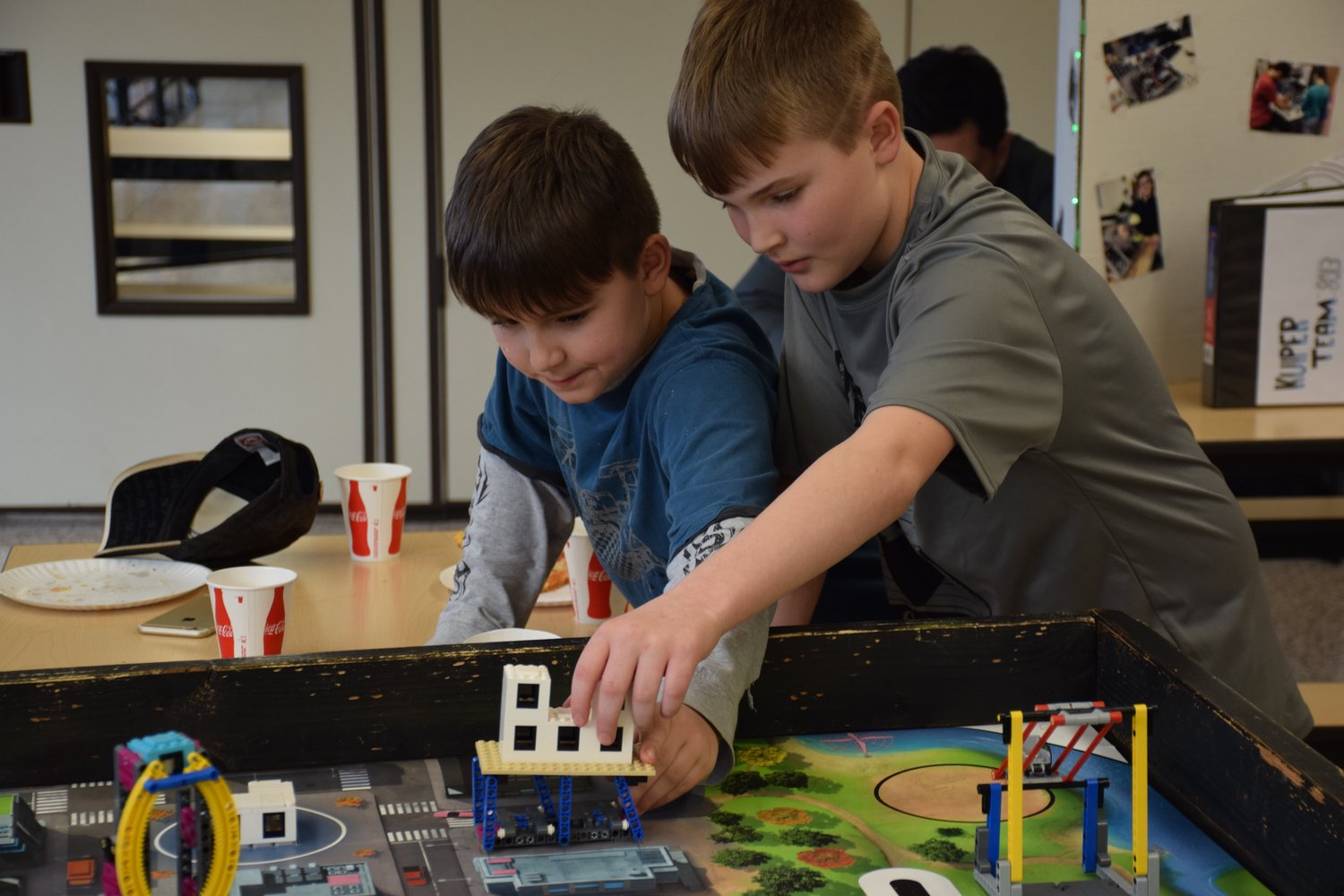 Fifth-graders Liam Reilly, left, and CJ McKenzie shared their Lego project with other students at Locust Valley Middle School.