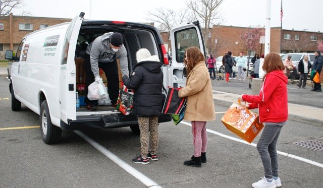 A volunteer from LI Cares handed out food to seniors on Friday.