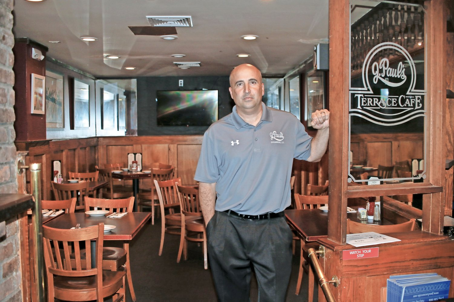 Joe Bonin, owner of J. Paul's Terrace Café in Oceanside, has opened the restaurant for takeout only. Other restaurants in the area have closed until further notice.