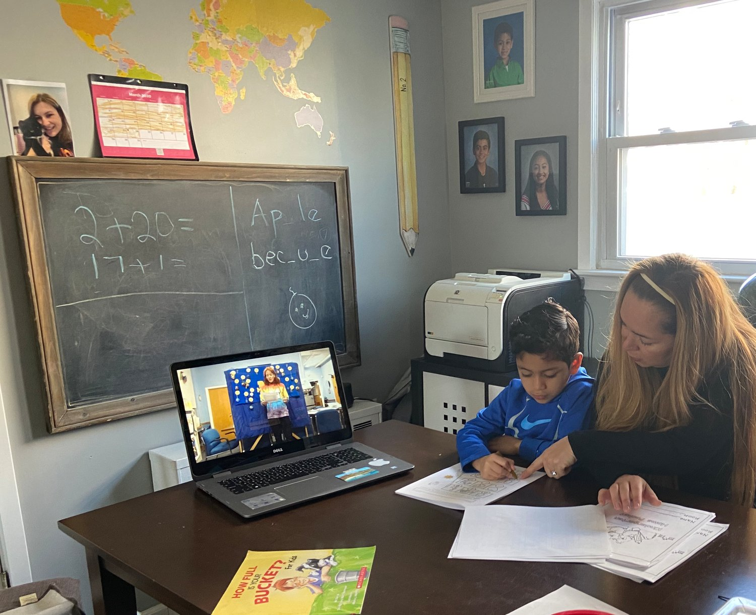 Students in the East Meadow School District have been adjusting to remote learning. Patsy Mustafich helped her son Sebastian a kindergartner at McVey Elementary School, complete a worksheet while they watched the morning announcements on YouTube.