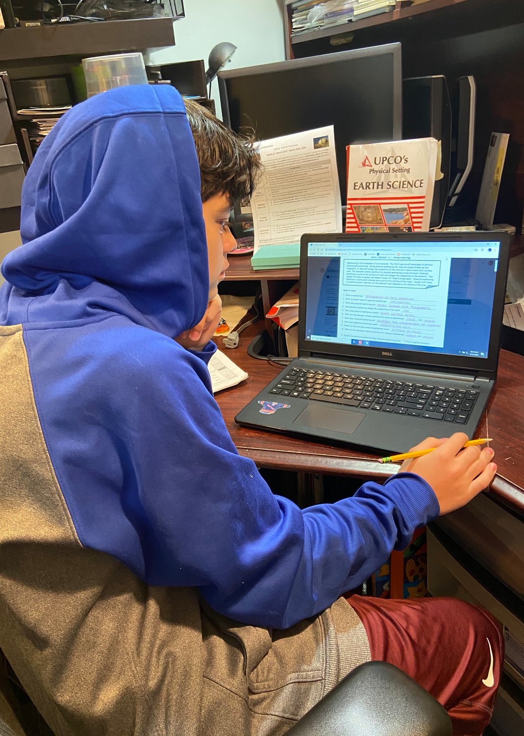 Aiden Mustafich, an eighth-grader at Woodland Middle School, and his sister Giselle, a freshman at East Meadow High School, have been following along with lesson plans through Google Classroom.