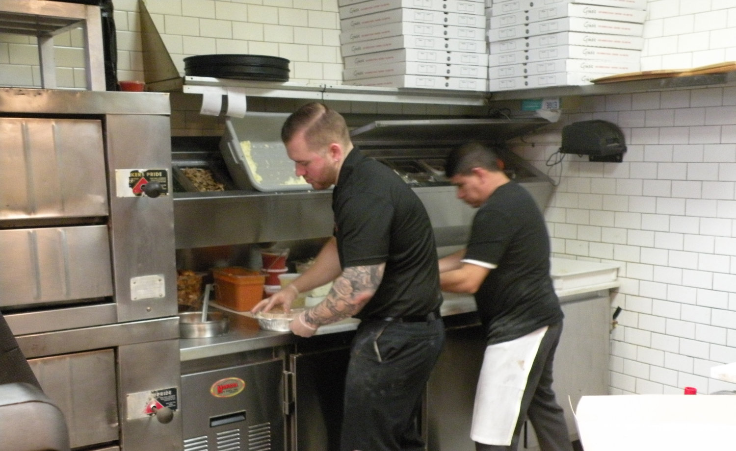 Gino's of Seaford co-owner Joseph Donlan, left, helped prepare pizza kits on Friday, March 20.