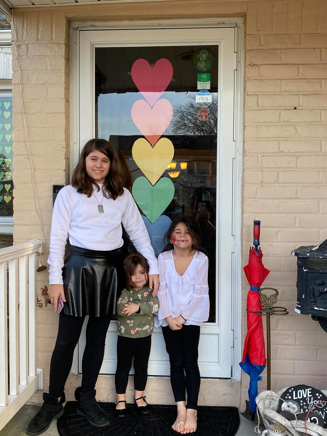 Vannessa Brown DeFalco worked with her daughters Christiana, 2,  and Valentina to make hearts.