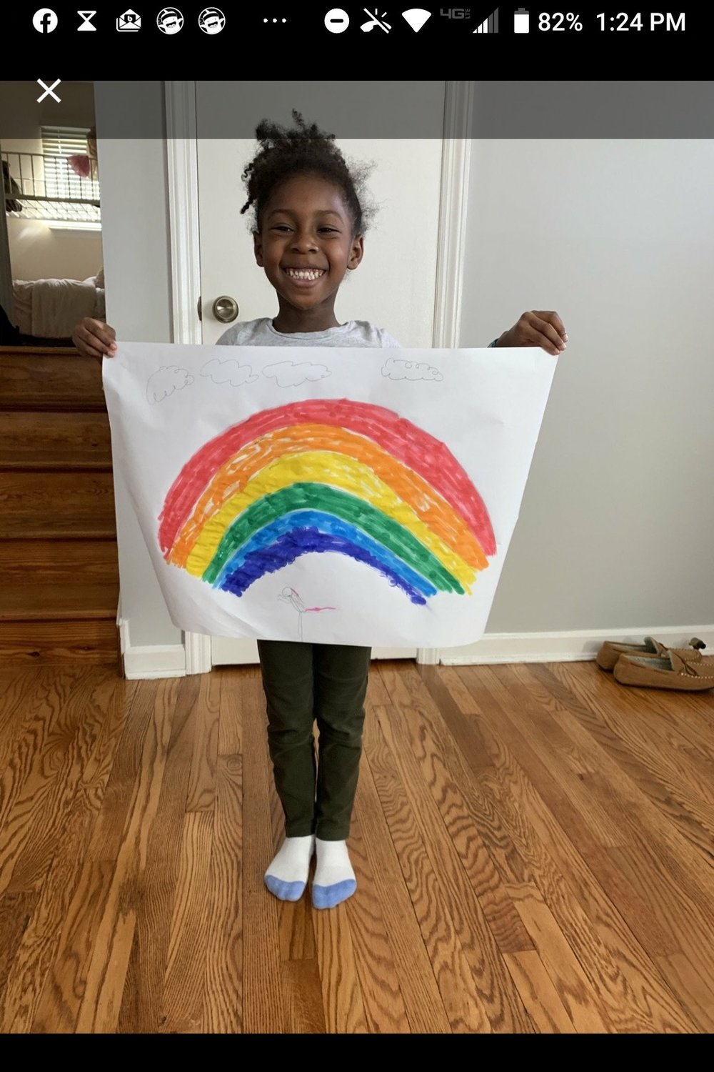 Isabelle Sammy, one of Wilder's students, below, crafted her own rainbow and walked around the neighborhood to find more.