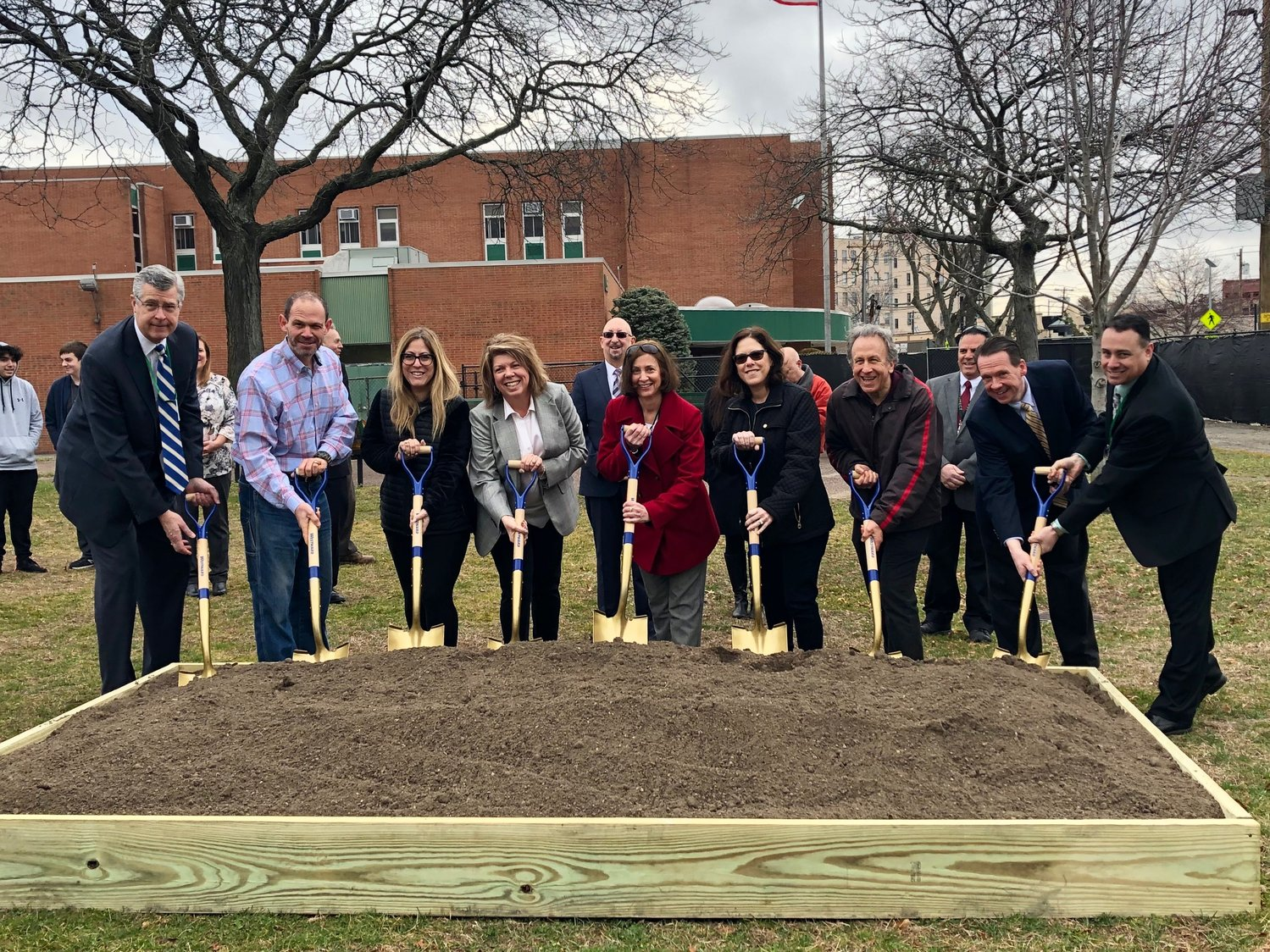Lynbrook school officials dug in at the groundbreaking for a 33,274-square-foot extension of the high school on March 12. The project was part of a $28.9 million bond proposal that voters approved in October 2017.