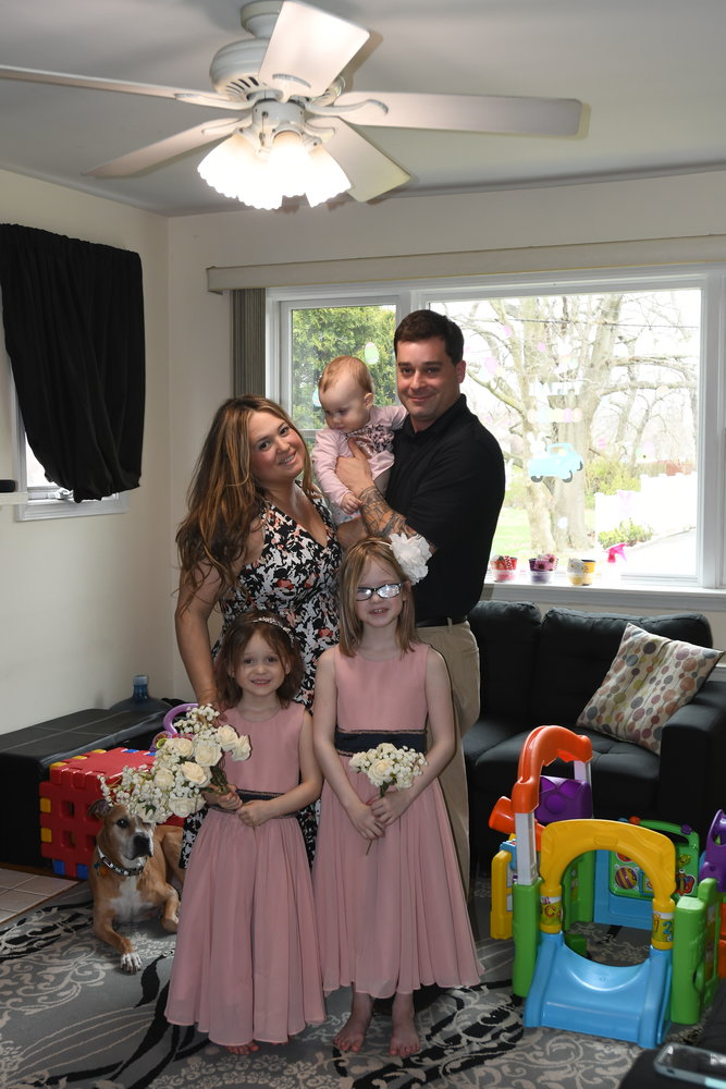 Allison Vardakis, left, and her husband Andrew, both of East Meadow, renewed their vows yesterday via FaceTime to celebrate their ninth anniversary. Their flower girls were their daughter's Sophia, 4, Holly, 7, and Olivia, 1.