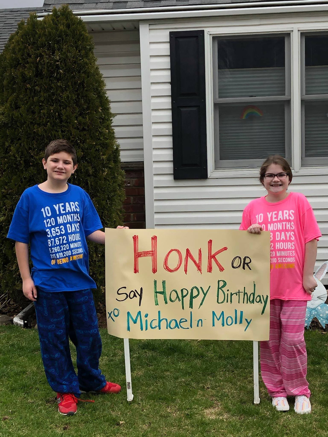 Michael and Molly Talbot's mother, Deborah, erected a sign on their front yard asking passersby to honk for the twins' birthday.