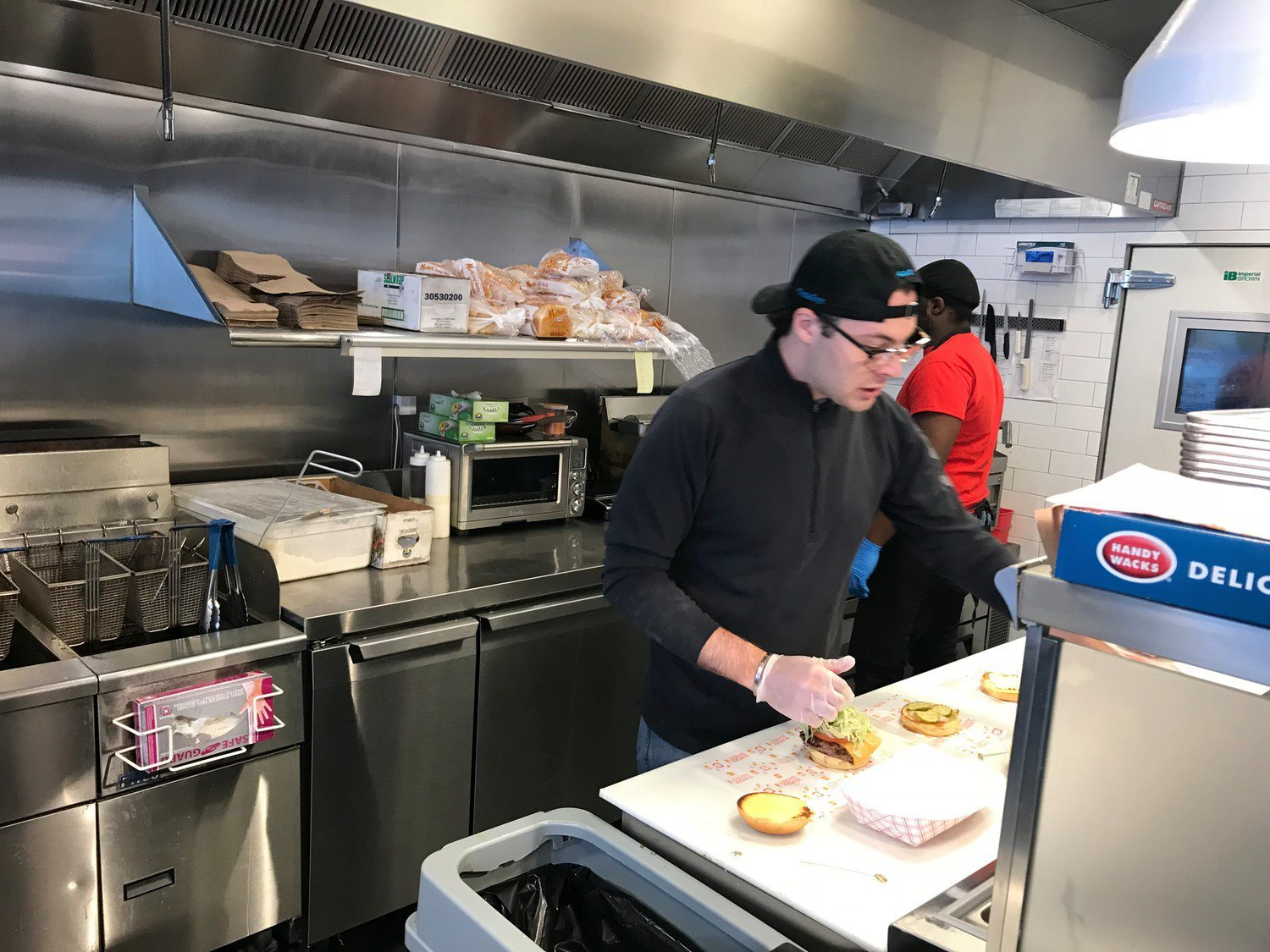 Burger Bandit owner Ryan Straschnow and his staff served about 200 meals to the staff at NYU Winthrop Hospital and homeless shelters on Friday.