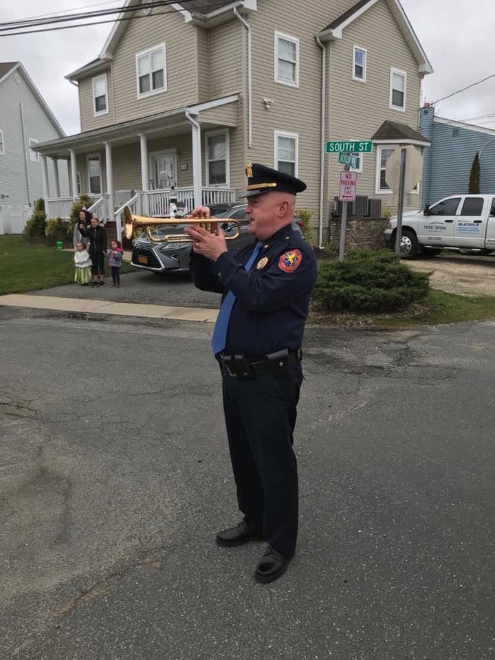 "Deputy Inspector Gus Kalin played ""Happy Birhday"" on his trumpet from the street."