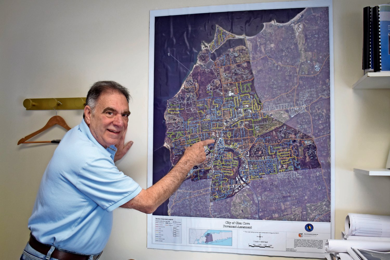 Glen Cove Department of Public Works Director Louis Saulino with a  map that details the conditions of every road in the city.