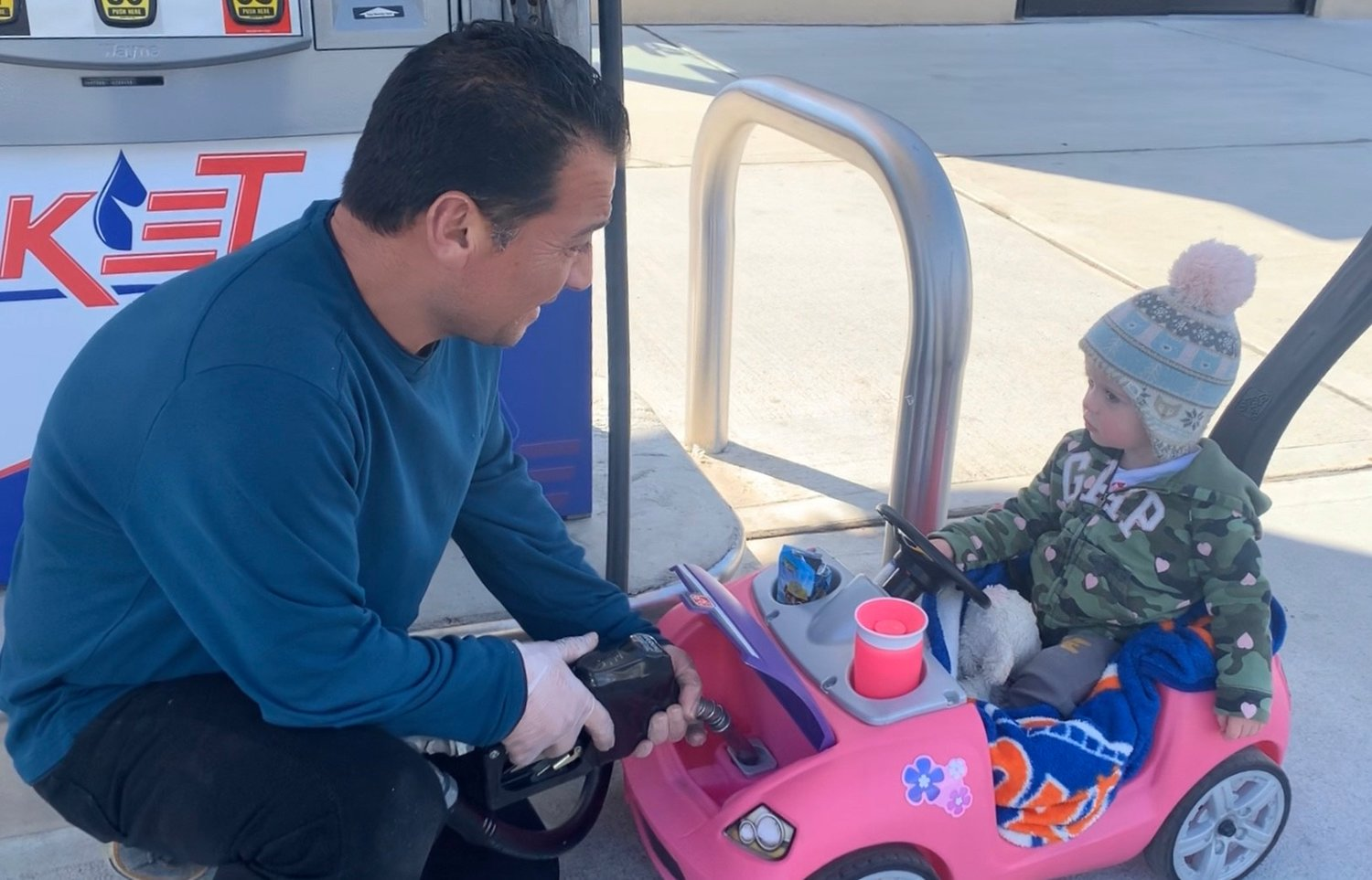 Akay Yalcinday fills up Ara Anderson's toy car at the Rocket Food Mart and gas station in Lynbrook regularly.