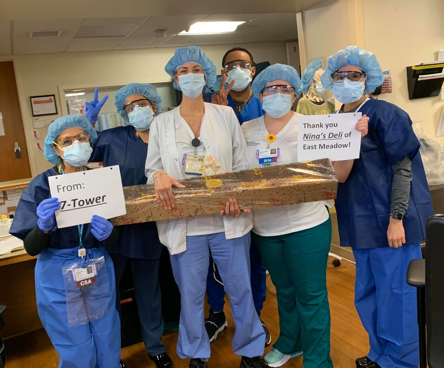 Staff members at North Shore University Hospital Manhasset got ready for a meal donated to them courtesy of Nina's Deli and Caterers in East Meadow.