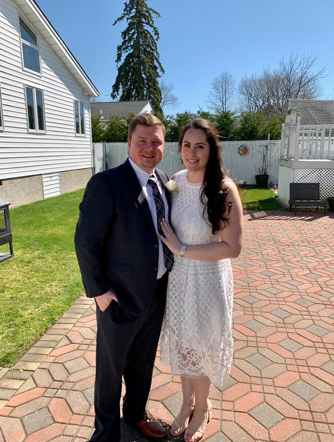 "After the coronavirus pandemic forced them to cancel their big wedding last Friday, John and Danielle Garren decided to get married in a ""socially distant"" ceremony in front of eight people in Danielle's parents' East Rockaway backyard."