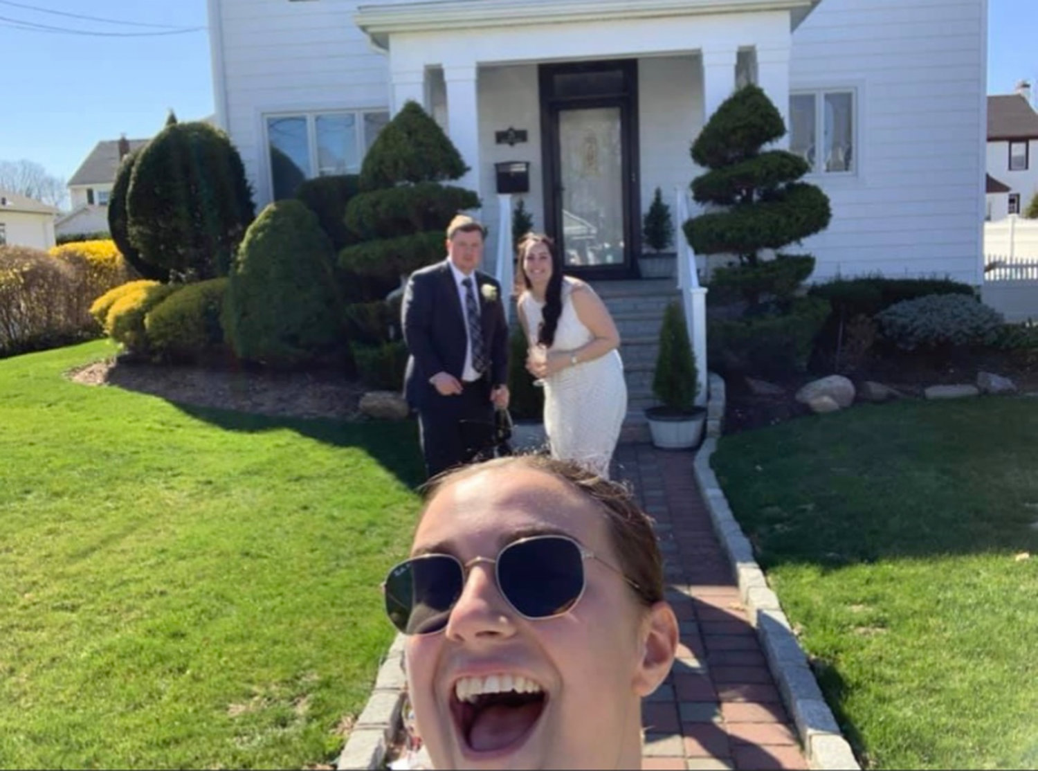 from a suitable distance, the groom's cousin Emily Garren took a selfie with the happy couple.