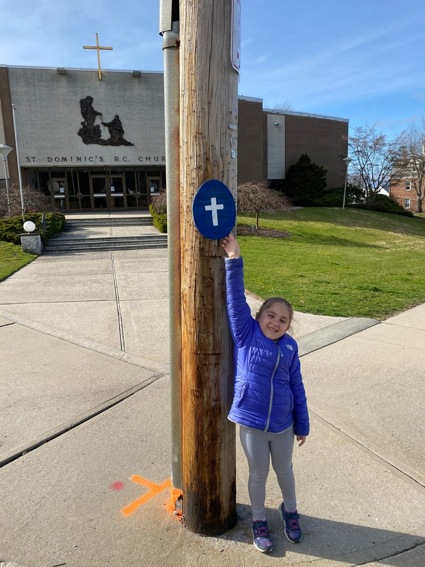 Theodore Roosevelt Elementary School kindergartner Olivia Micelli followed the route for the egg hunt finding one in front of St. Dominic's Church.