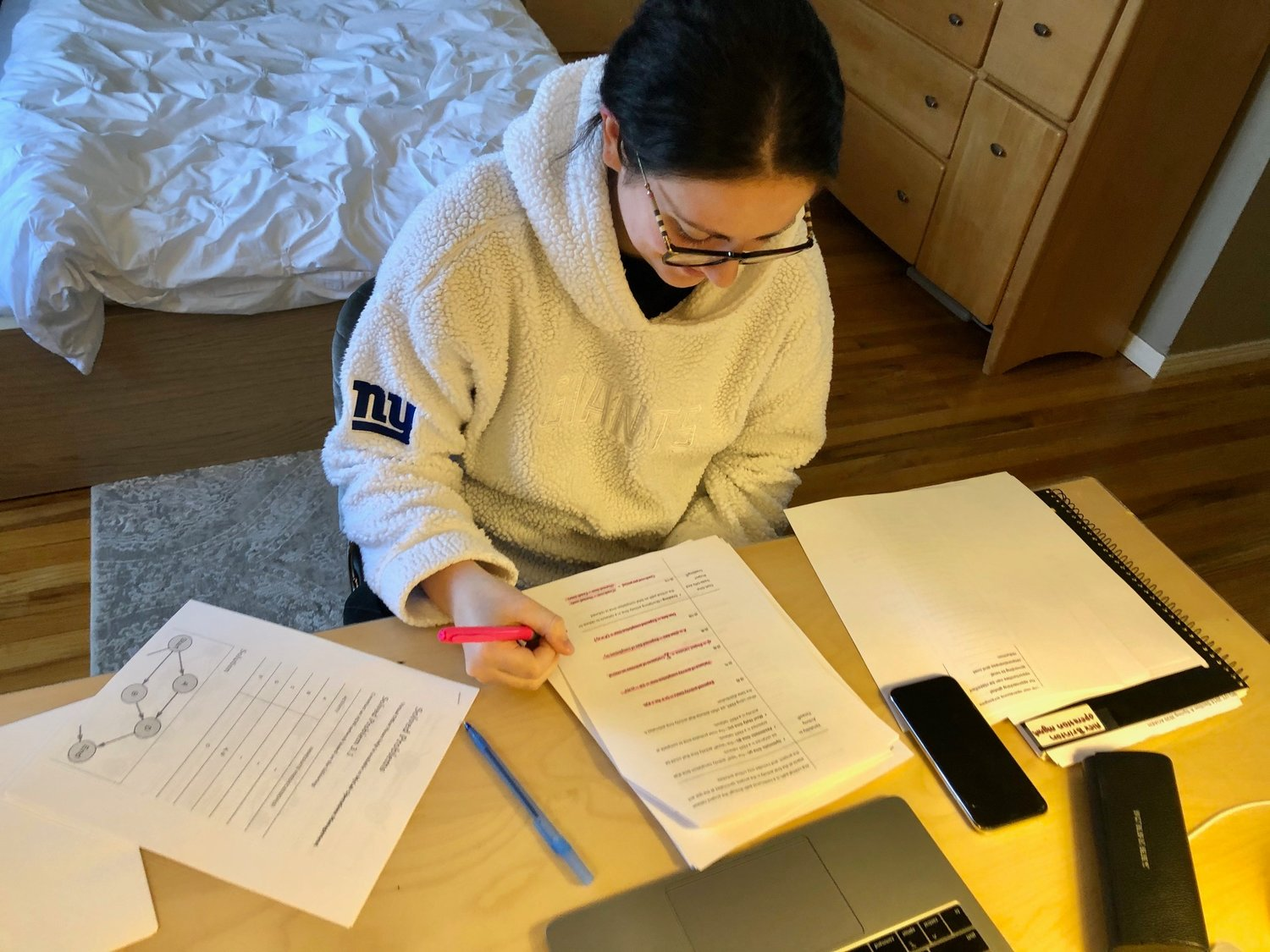 Most college students are not returning for classes this semester and are learning virtually from home. Above, Alexandra Brinton, of Merrick, a New York University sophomore and daughter of Herald Executive Editor Scott Brinton, hard at work studying on April Fool's Day.