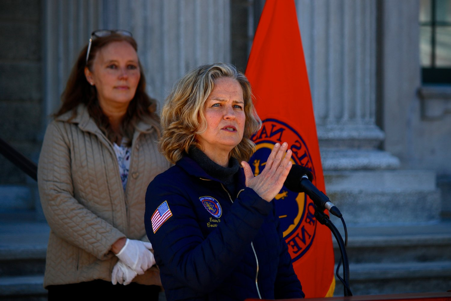 Nassau County Executive Laura Curran said Saturday afternoon that 149 people had died of the coronavirus in Nassau County to date. That contradicted a state report, which put the total number of deaths significantly higher than that, she said. At back was Nassau County Legislator Delia DeRiggi-Whitton, who represents the 11th District on the North Shore.