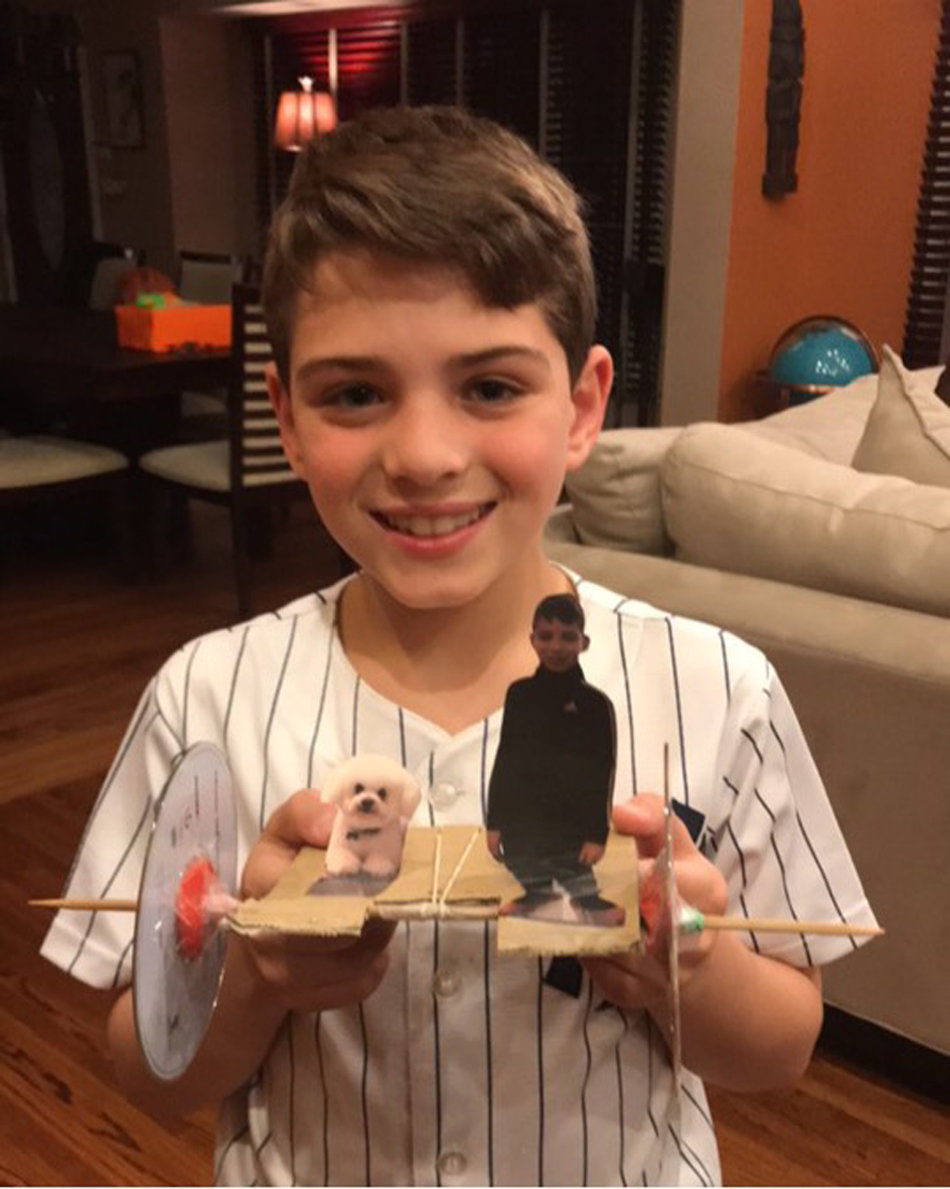 Mandalay Elementary School third-grader Michael Coticchio participated in the Design Squad Home Challenge by making a rubber band racer.