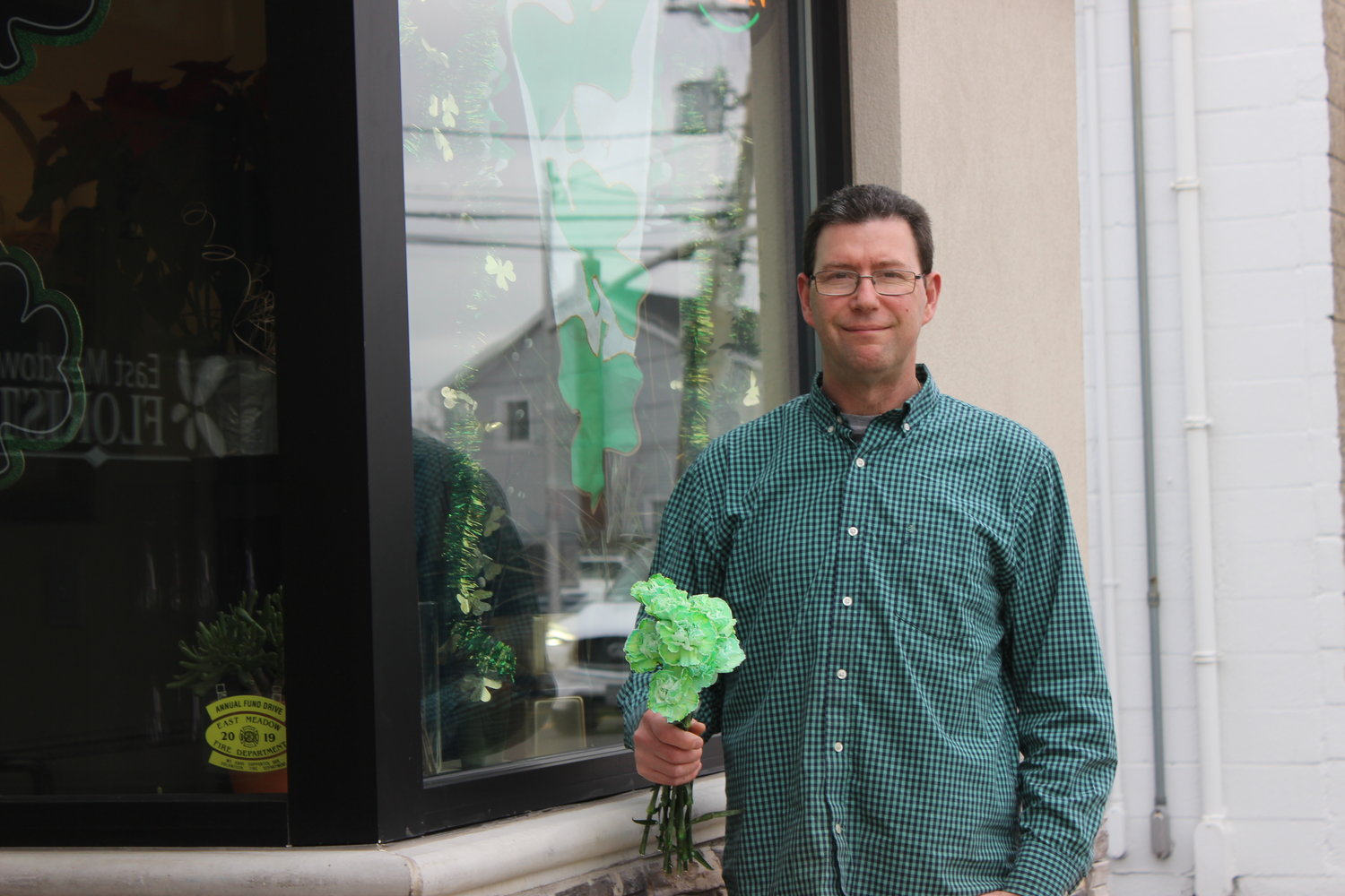 The East Meadow Florist is still ringing in the spring and open for pickup and delivery. Owner Chris Hackert gave away 500 green carnations after St. Patrick's Day when an order was canceled.