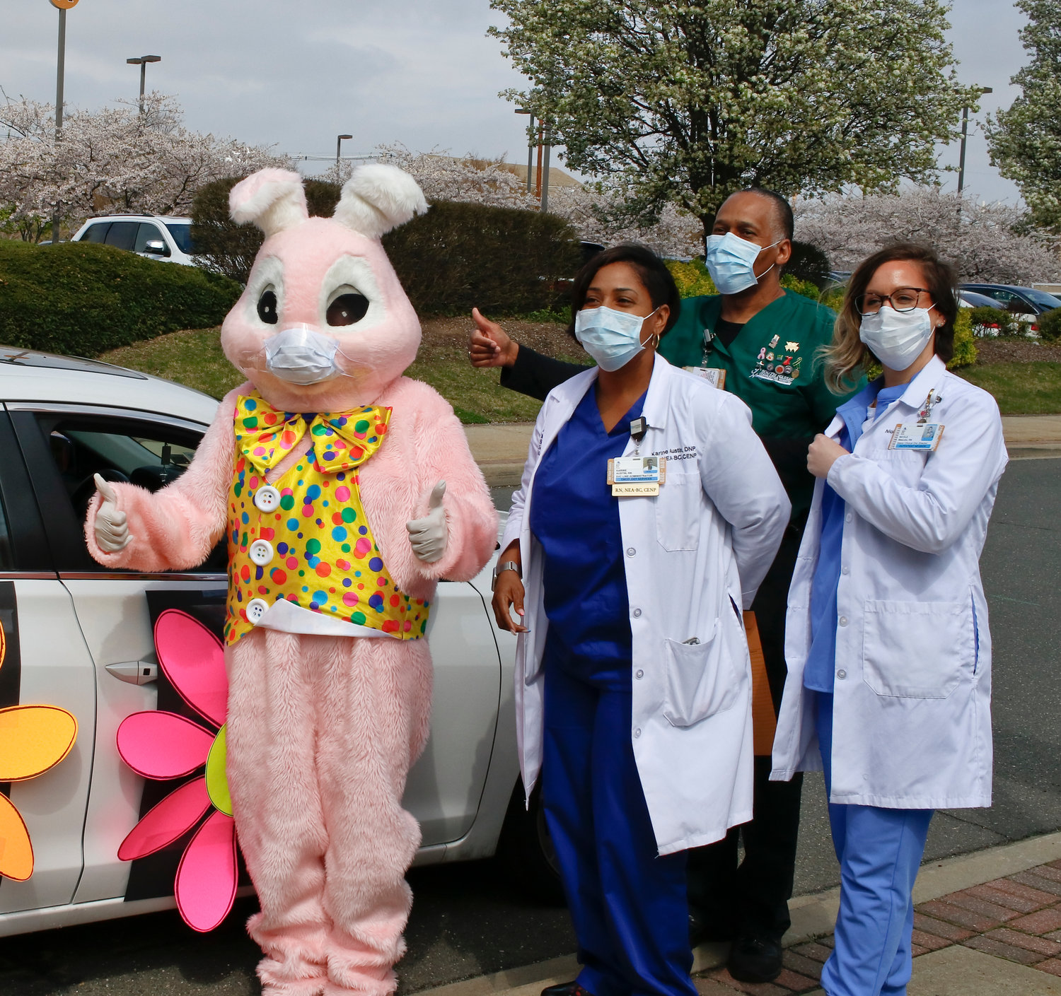 Even the Easter bunny made an appearance at the parade, mask and all, and spent some time with, from left, Nurse Karine Austin, Willie Wright and Nurse Nicole Mascolo.