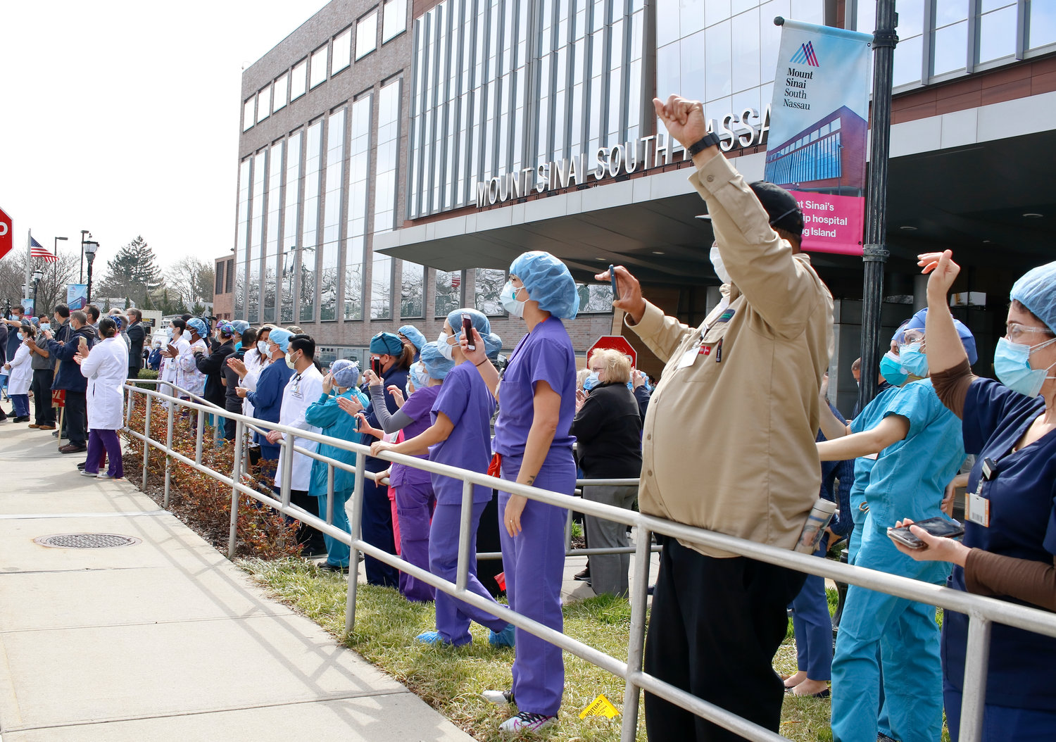Front-line workers at Mount Sinai South Nassau Hospital in Oceanside came outside to greet hundreds of cars that drove by in a parade to support them.